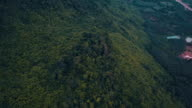 Aerial view flying over jungle mountain peaks. Thailand.