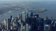 Aerial view flying over the skyscrapers of Lower Manhattan and New York City's Financial District.