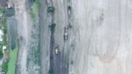 Aerial view : Grader working at construction site.