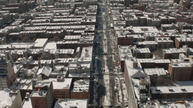 Aerial View Heading South on 7th Ave In Harlem New York City On A Sunny Winter Day