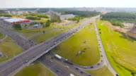 Aerial view highway, freeway, urban city transportation. Rush Hour. Cars Passing