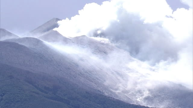 Aerial view Mount Shindake covered with ash Pan right Ashcovered mountain