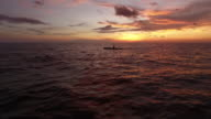 Aerial view of a fisherman with sunset as its background in the sea of Ternate, eastern part of Indonesia