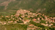 Aerial view of a hilltop village with the Abruzzo Mountains in background / Abruzzi, Italy