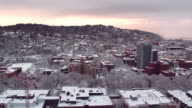 Aerial view of a sunset over a snow covered city