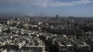 Aerial view of Aleppo showing explosions as Syrian government forces do battle with rebels