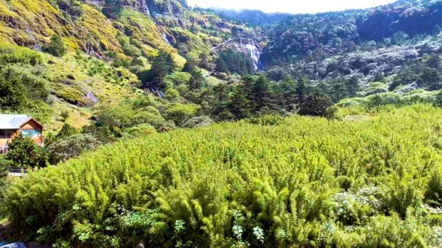 Aerial View of Amazing Waterfall Along Beautiful Green Mountain, Jiaozi Mountain, Yunnan Province, China