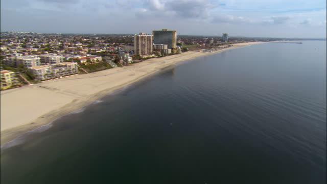 Aerial view of beach and hotels along coastline / Long Beach, California