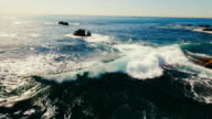 Aerial view of beautiful Laguna Beach's waves breaking in the summer sun.