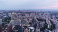 T/L PAN Aerial View of Beijing Skyline at Night, Day to Night Transition