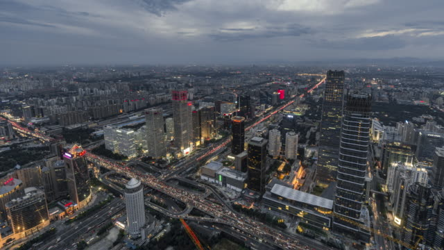 T/L WS HA TU Aerial View of Beijing Skyline, Day to Night Transition / Beijing, China
