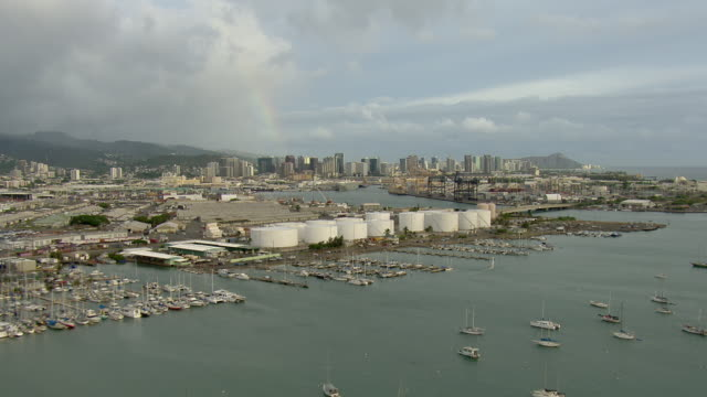 Aerial view of boats at the Keehi Marine Center with distant view of Honolulu skyscrapers.