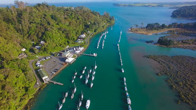 Aerial View Of Boats parked at Stillwater with Rangitoto Island in background.