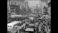 / Aerial view of busy intersections in downtown Newark / CU sign 'Market Street' / trolleys trams people and crowded streets Downtown Newark NJ on...