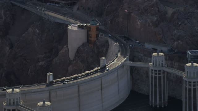 Aerial View Of Cars Driving Along The Hoover Dam
