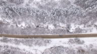 4K Aerial view of cars on snow road