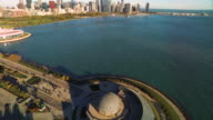 Aerial view of Chicago skyline panning to Adler Planetarium in Chicago Harbor
