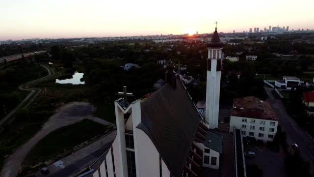 Aerial view of church. Cityscape in the background