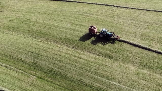 Aerial view of combing harvester harvesting farm