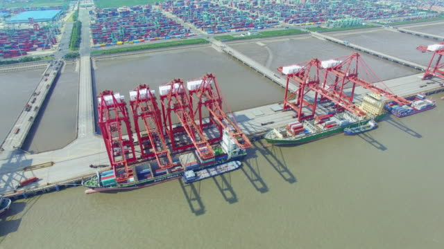 Aerial view of commercial dock with cargo containers in shanghai.