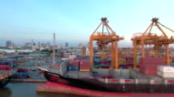 Aerial View of Container Ship in Industrial Port at Sunset