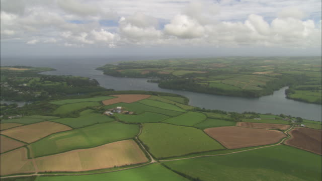 Aerial view of Cornwall, England, river inland and village, green fields, Cornwall, UK