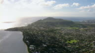 Aerial view of Diamond Head Crater and distant skyscrapers in Honolulu, Hawaii.