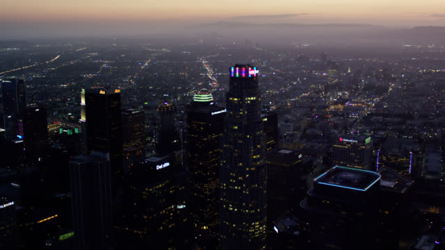 aerial view of Downtown Los Angeles (DTLA) skyscrapers looking west towards the ocean and the Hollywood Hills