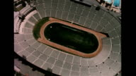 / Aerial view of empty stadium identified as LA Memorial Coliseum and Dodger Stadium / game in progress between New York Yankees and Los Angeles'...