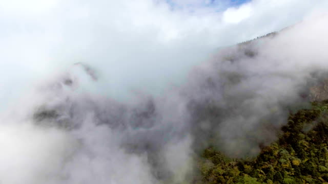 Aerial view of Fog Flowing over Green Mountain in Beautiful Day, Jiaozi Mountain, China