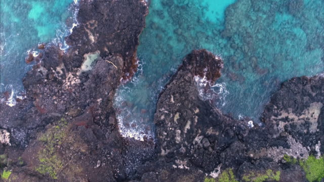 Aerial View of Hawaiian cliffs and blue ocean by drone in 4k