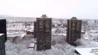 Aerial view of high rise apartments in a snowy city