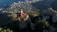 Aerial view of hiker female on top of mountain