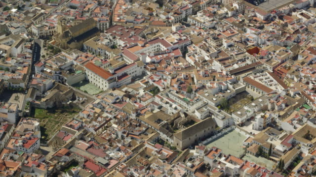 aerial view of historic city center of Cordoba with Cathedral-Mosque in center and Roman bridge spanning Guadalquivir river
