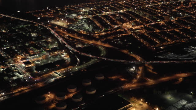 aerial view of illuminated highway traffic road at night. cars transportation background