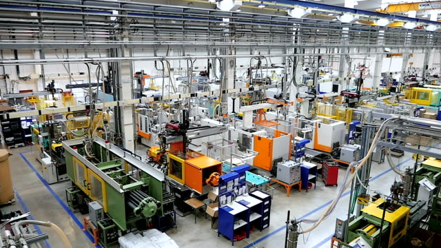 Aerial view of injection molding machines in factory