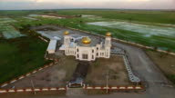 Aerial view of islamic mosque on sunset