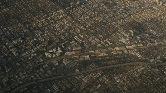 Aerial view of Los Angeles Suburbs out of plane window 4k
