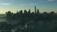 Aerial view of lower Manhattan and Bridges from Brooklyn and East River NYC snow