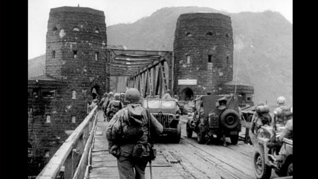 WWII aerial view of Ludendorff bridge American troops and tanks crossing the bridge / military map of Rhine River area WWII Ludendorff Bridge at...