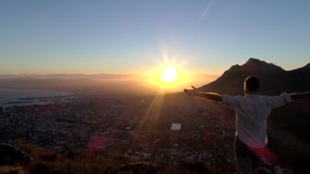 Aerial view of man welcoming the sun
