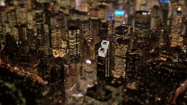 aerial view of metropolis city skyscraper buildings at night