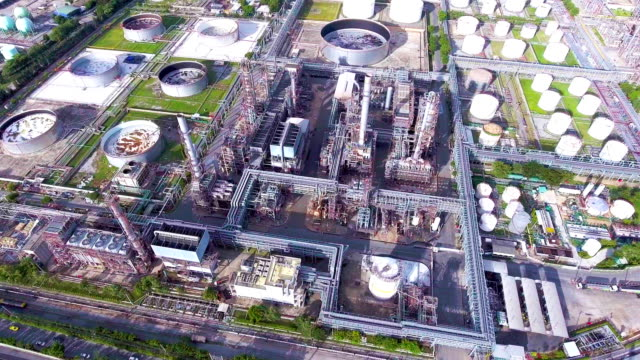 Aerial View of Oil Refinery near River, Bangkok, Thailand. Flying Around Chemical Plant with Complex Pipe in the Morning