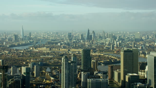 Aerial view of River Thames and city buildings