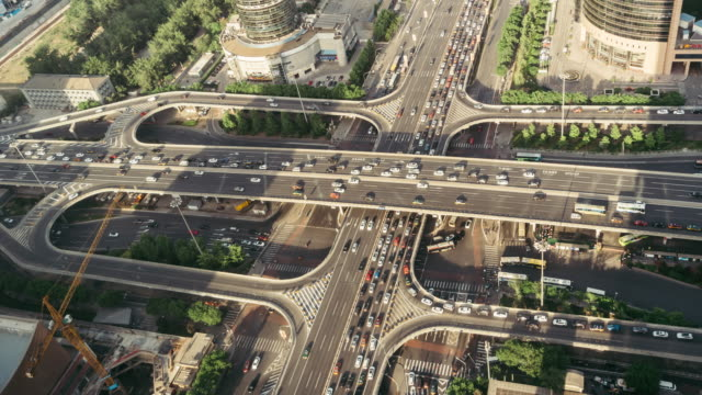 T/L PAN Aerial View of Road Intersection in Sunlight / Beijing, China