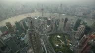 WS Aerial view of Shanghai skyline and the Huang Pu River.