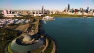 Aerial view of Shedd Aquarium and Adler Planetarium on Chicago Harbor