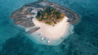Aerial (drone) view of small tropical island at sunset