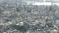 Aerial view of snow covered harborside buildings and Tokyo Tower in Tokyo.