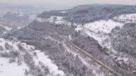 4K Aerial view of snow mountain and a road